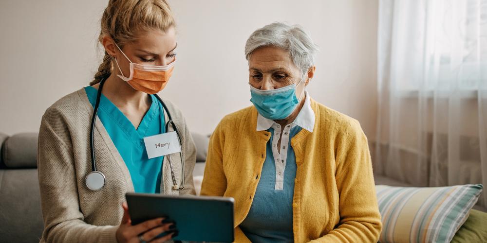 Elderly Masked Woman with Nurse