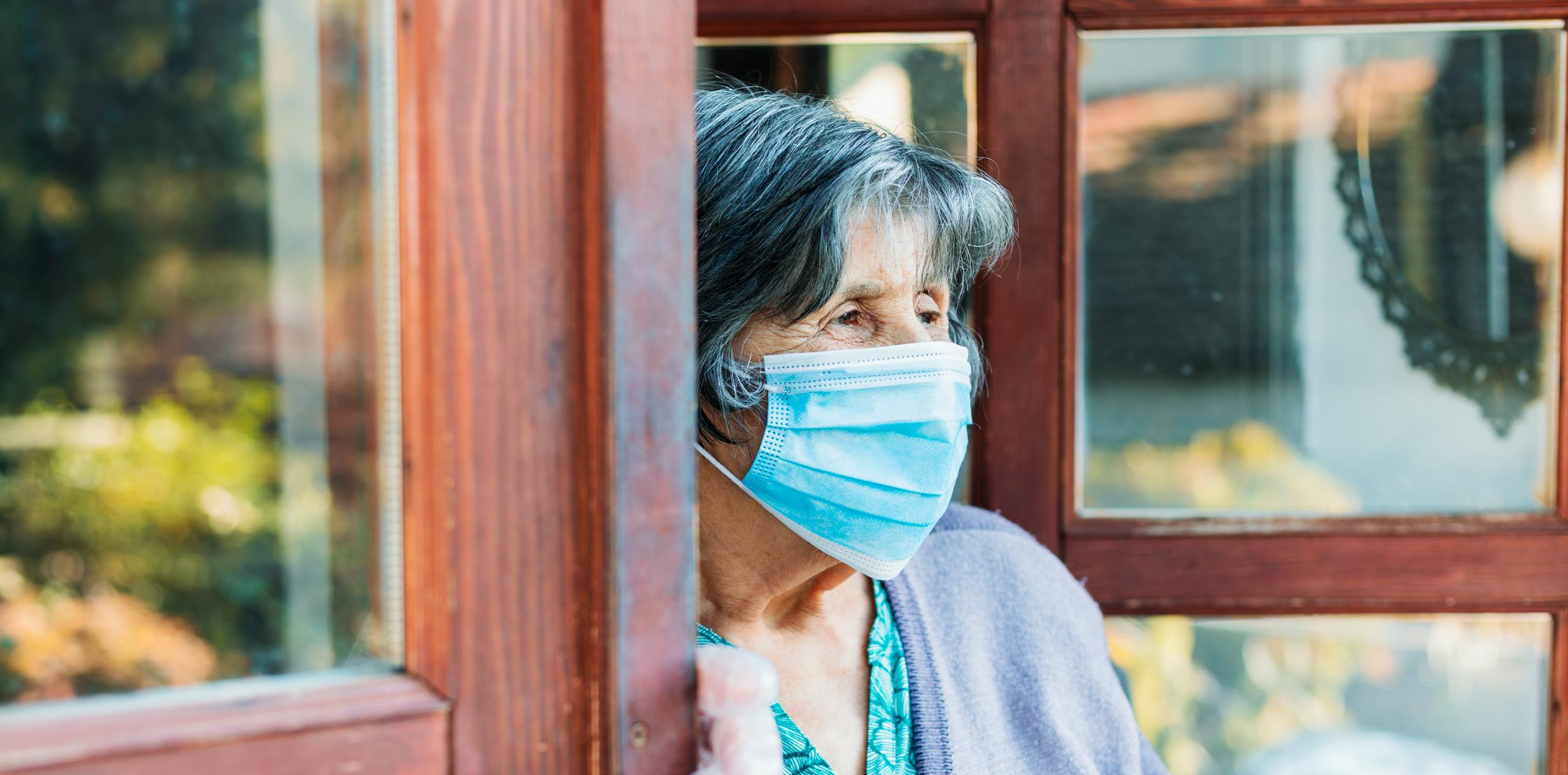 Elderly Woman in Mask Against Covid-19