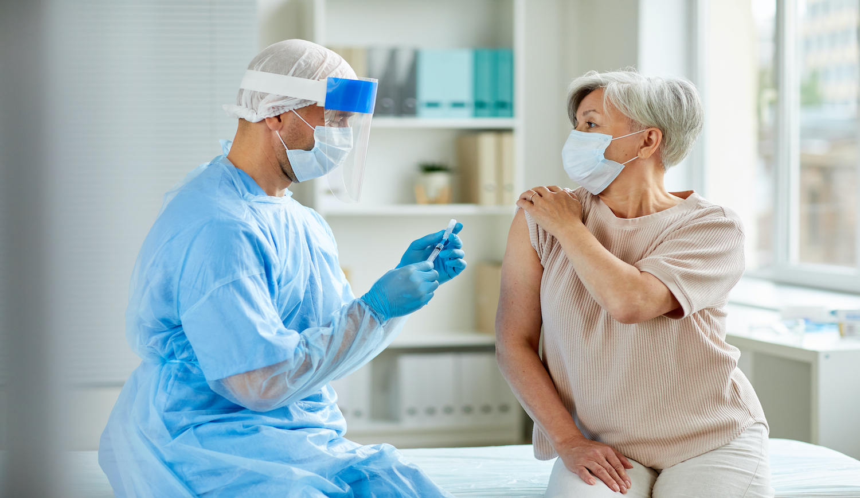 Male Nurse Preparing Injection