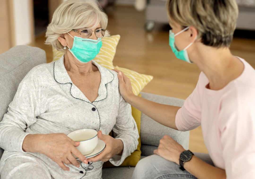 Daughter And Senior Mother Wearing Mask Full